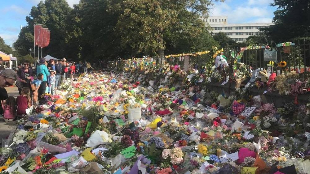 Flowers and cards for the victims of the Christchurch shooting at the Botanic Gardens.
