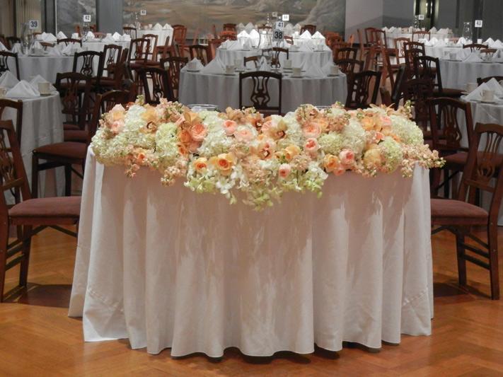 wedding flower centerpiece by red poppy floral design