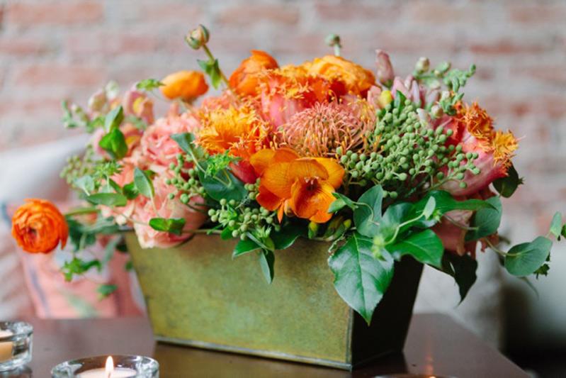 orange and peach flower centerpiece