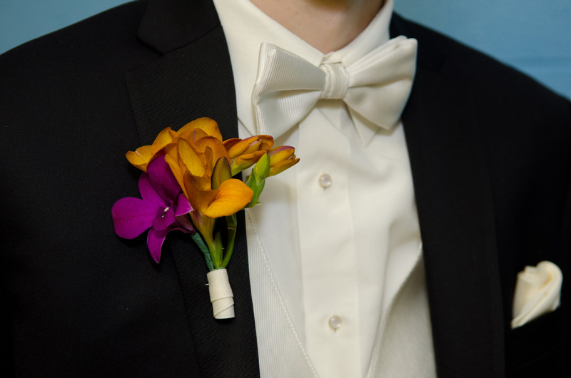orange and purple groom boutonniere