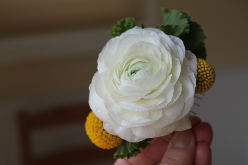 wedding hair comb of white ranunculus and yellow craspedia