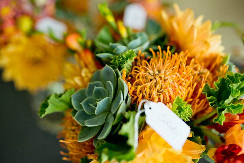 natural orange and green bouquet by red poppy floral design ann arbor