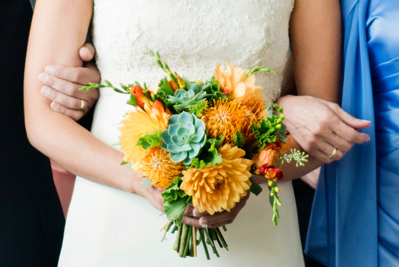 wedding flowers orange dahlias and succulents