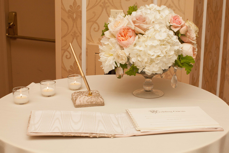 guest book flowers in peach, pink, white at the Dearborn Inn