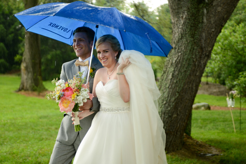 couple in the rain with wildflower bouquet
