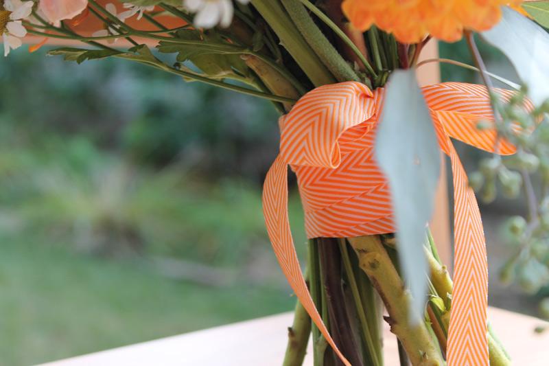 bridal bouquet with orange chevron ribbon