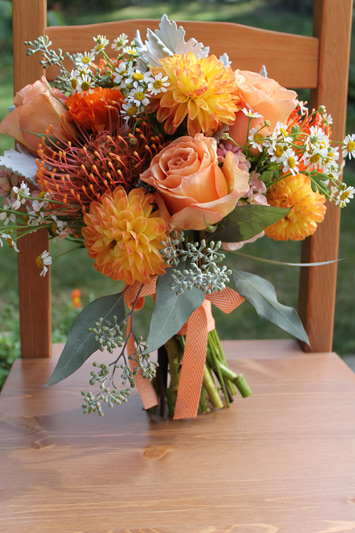 orange bride bouquet with chevron ribbon