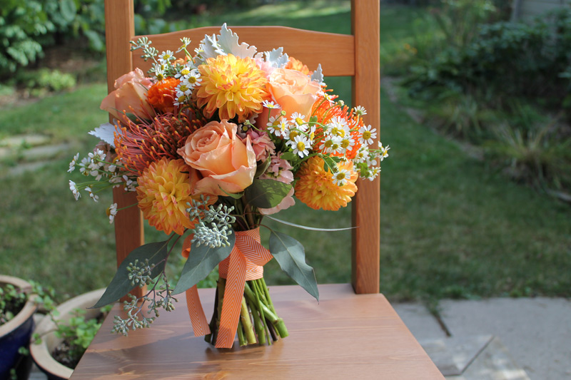 orange autumn wedding bride's bouquet with contemporary chevron ribbon