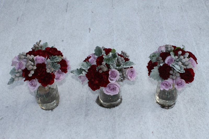 bridesmaid bouquets in lavender, silver, burgundy