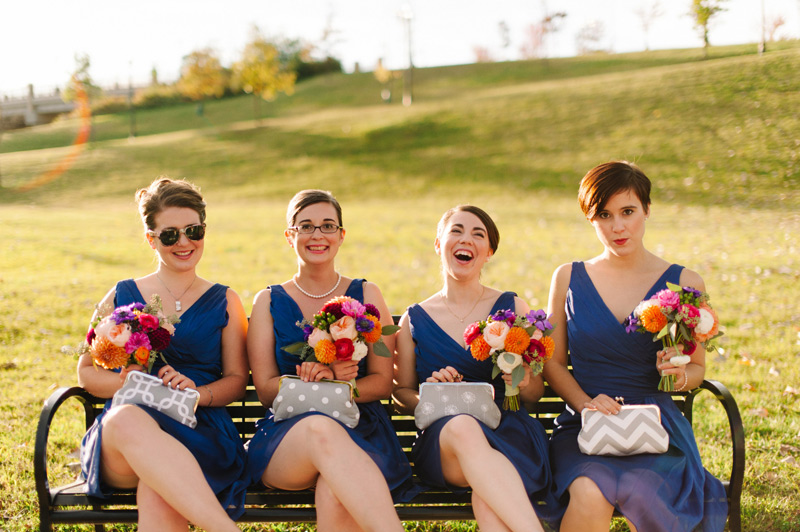 stylish bridesmaids on park bench, autumn ann arbor wedding