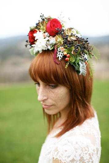 fancy flower hair piece featuring red piano garden roses and textured foliage