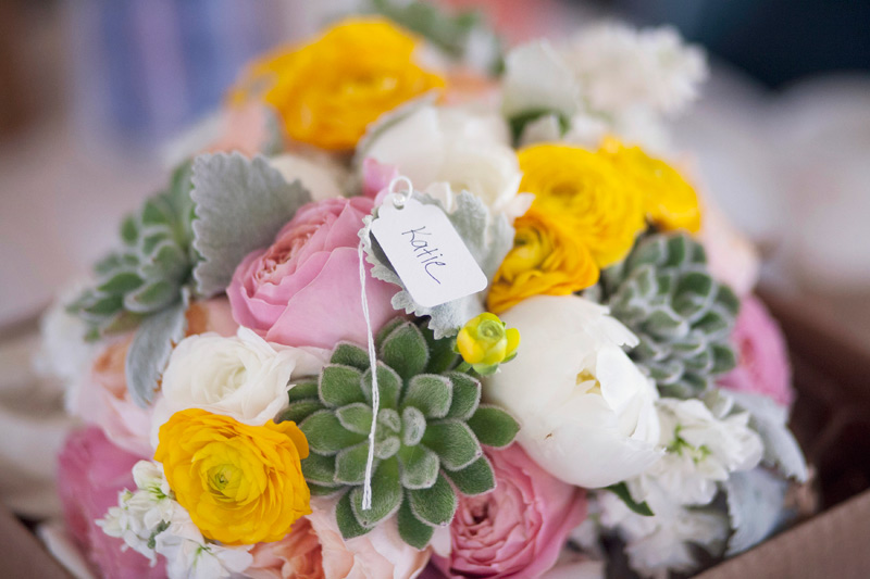 spring wedding flowers in pink, white, yellow, and green