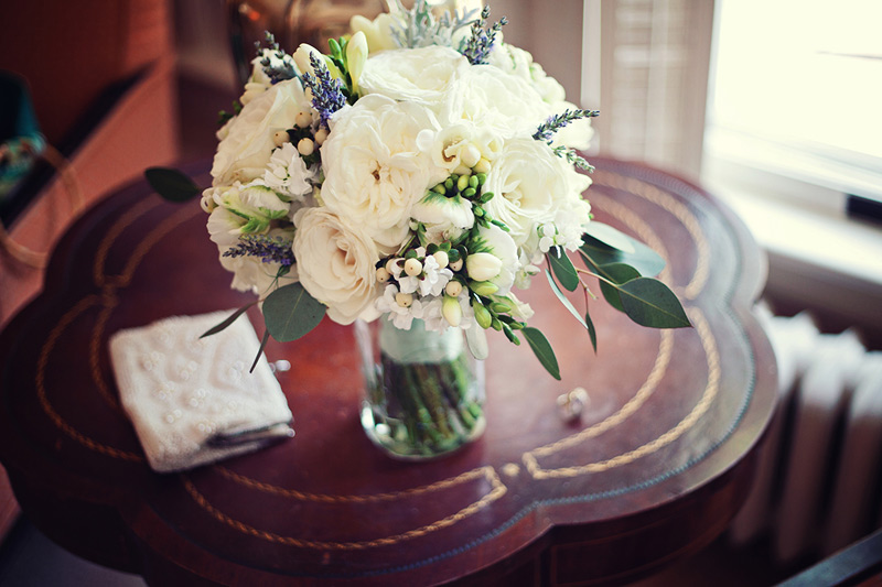 brides bouquet of white garden roses, lavender and fresh herbs