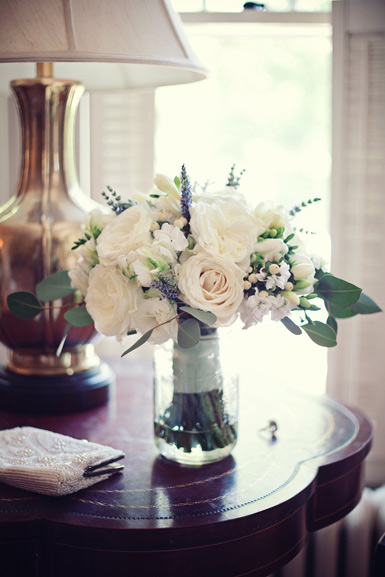 wedding flowers of ivory garden roses, lavender, and fresh herbs