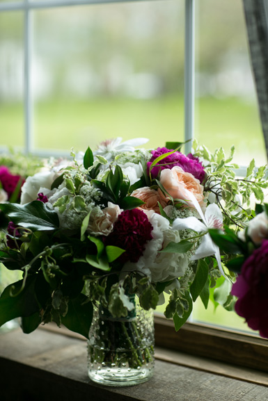 wedding flowers in raspberry pink, peach, white, and green