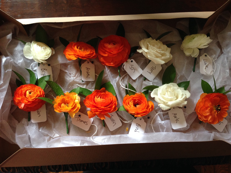 orange and white wedding boutonnieres by red poppy floral design ann arbor michigan