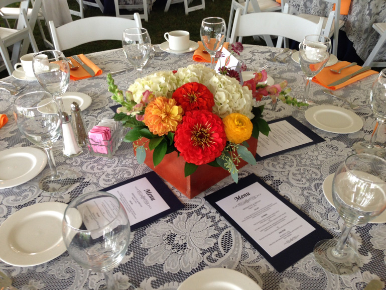 peach orange coral wedding flower centerpieces at grosse pointe academy by red poppy floral design ann arbor michigan