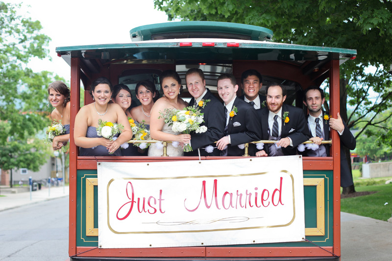 ann arbor wedding party celebrating on trolley