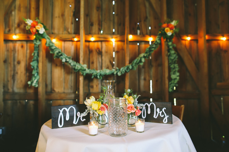 vintage style sweetheart table garland and flowers