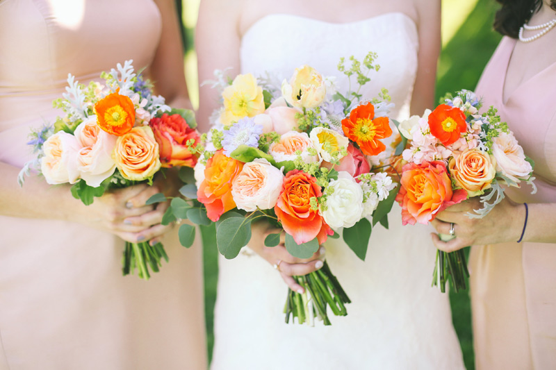 wedding party flowers in orange and peach