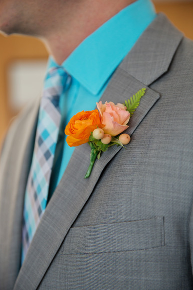 groom boutonniere in peach and orange