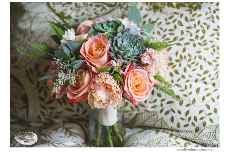 blush and peach wedding bouquet with succulents