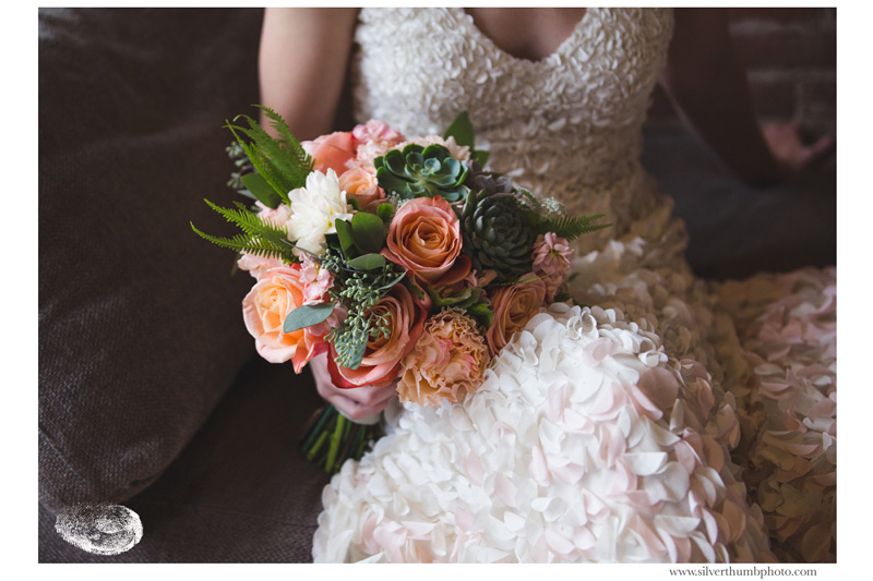bride's bouquet in blush, peach and ivory with succulents