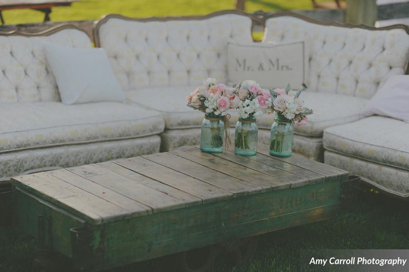 vintage sofa and coffee table at farm wedding
