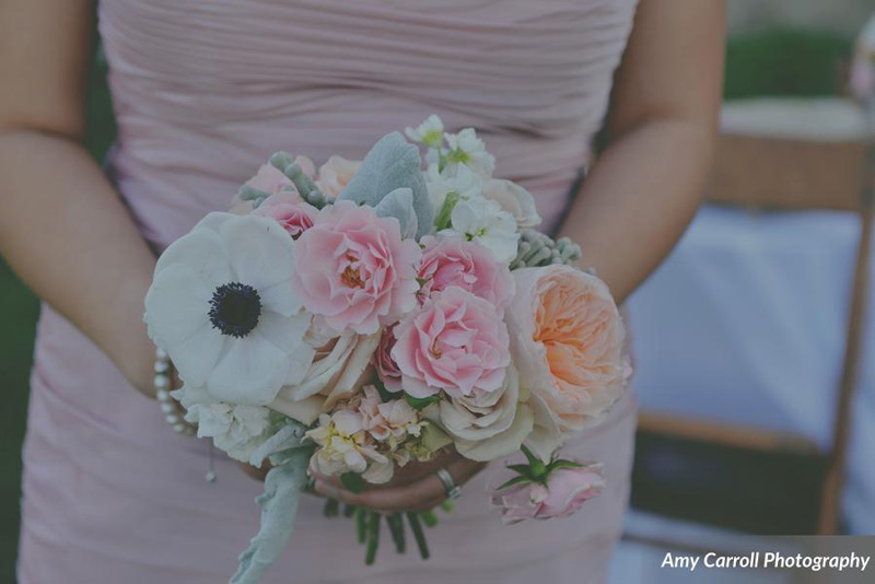 wedding flowers in blush peach and ivory at michigan farm wedding