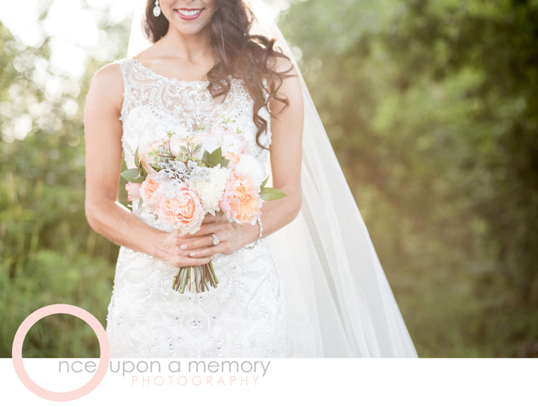 bride bouquet in peach and ivory garden roses