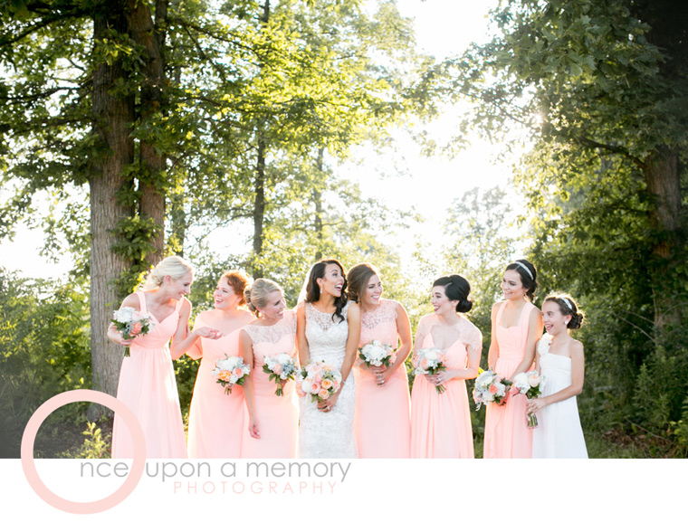 bridal party in peach and ivory