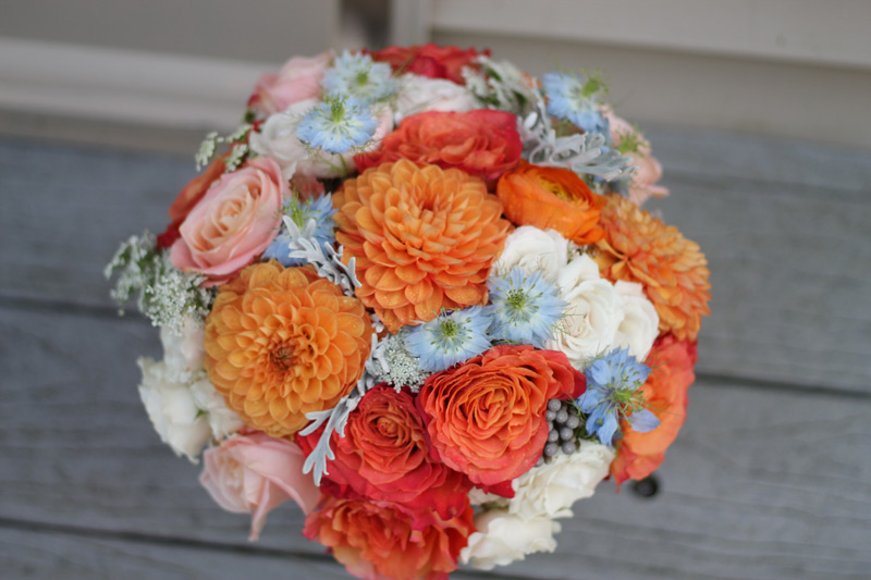 orange blush peach pink blue wedding bouquet