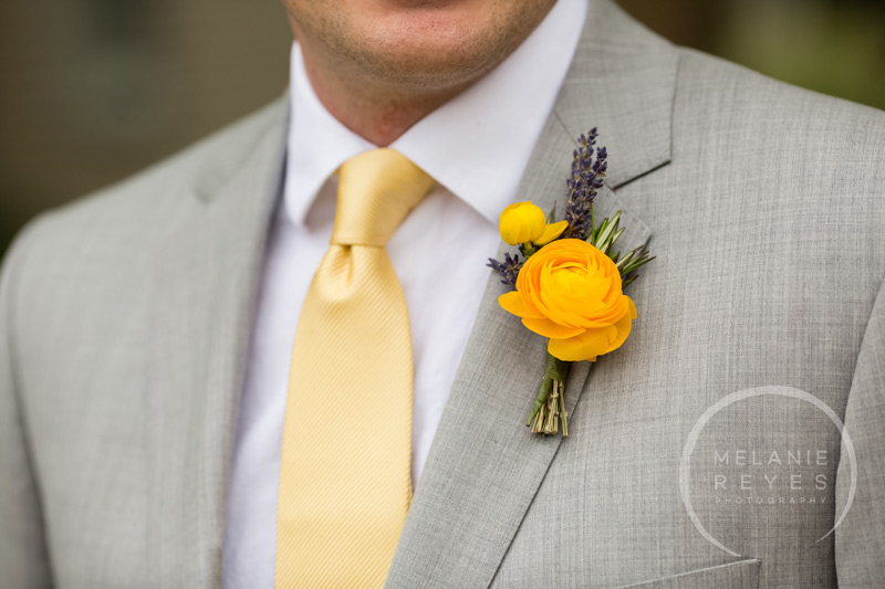 groom boutonniere yellow ranunculus and lavender