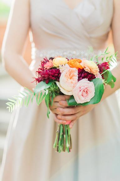 bridesmaids bouquet in peach, blush, burgundy and orange