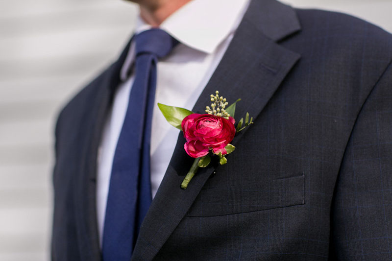 wedding party boutonniere burgundy ranunculus