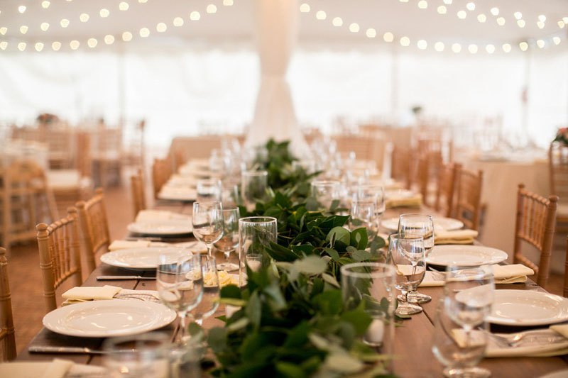 foliage garland centerpiece at zingermans cornman farms wedding