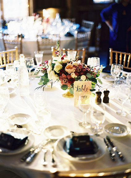 wedding reception centerpieces in gold compote dish