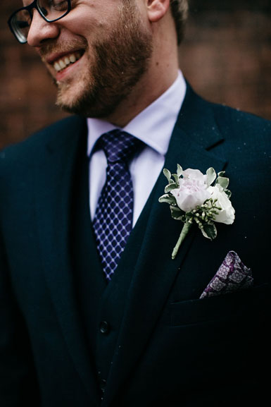 winter wedding groom boutonniere