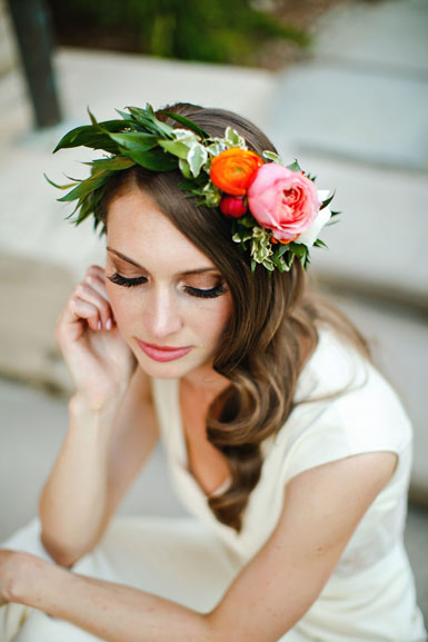 wedding hair flowers in coral, orange and pink