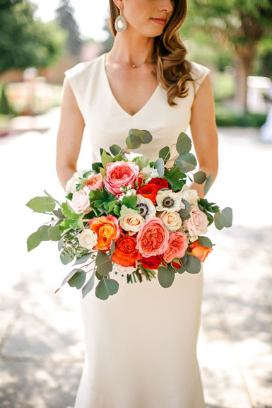 wedding bouquet in coral pink orange and white