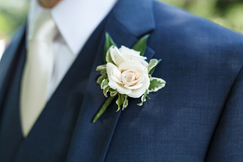 groom boutonniere in ivory ann arbor wedding