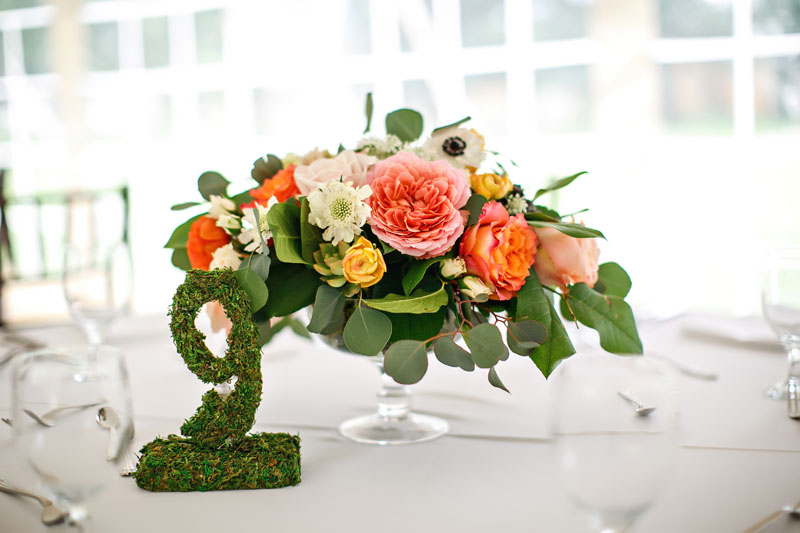 wedding centerpiece in pink peach orange and ivory flowers