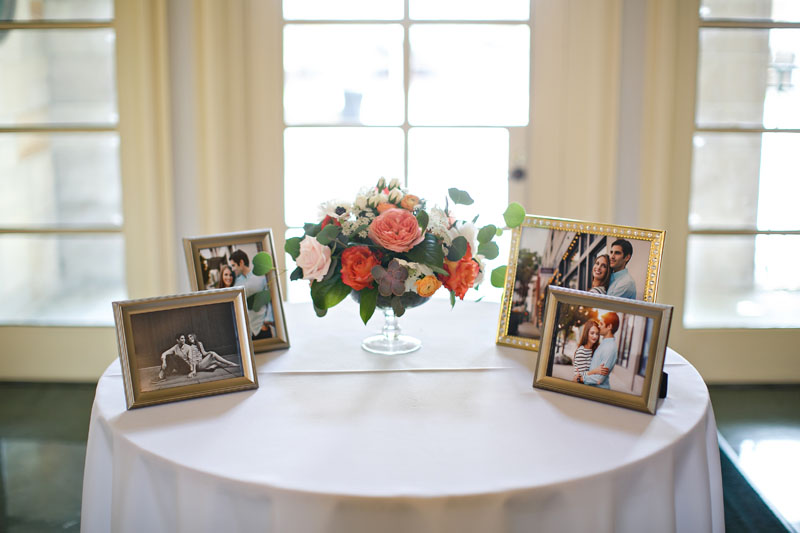 wedding entry welcome table with photos and flowers
