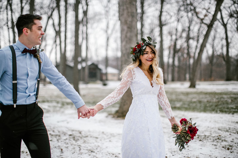 bride and groom enjoying snow