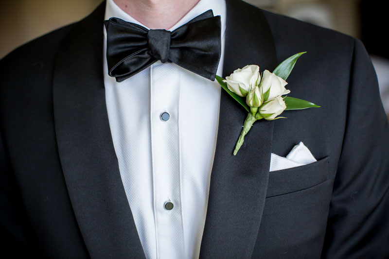 groom boutonniere in blush and ivory