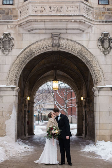 snow photos of bride and groom on campus ann arbor