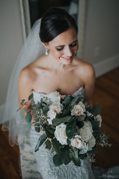 winter wedding bride with green and white bouquet