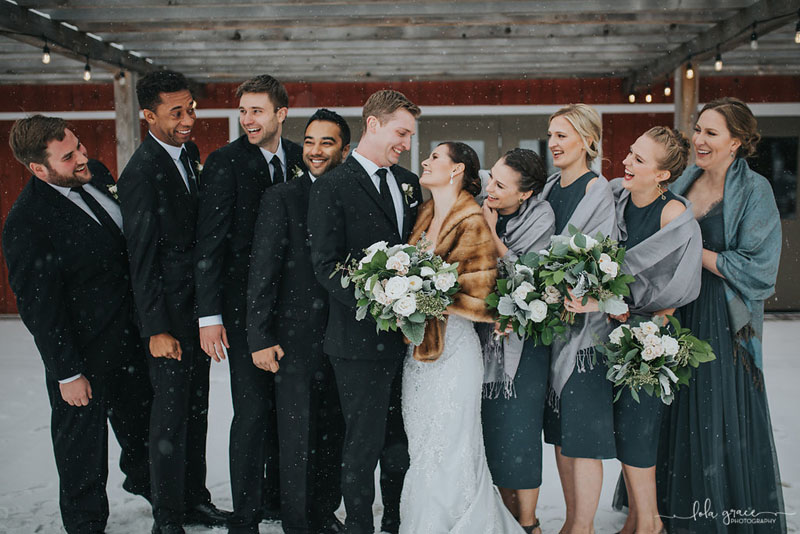 bridal party in snow at zingermans cornman farm