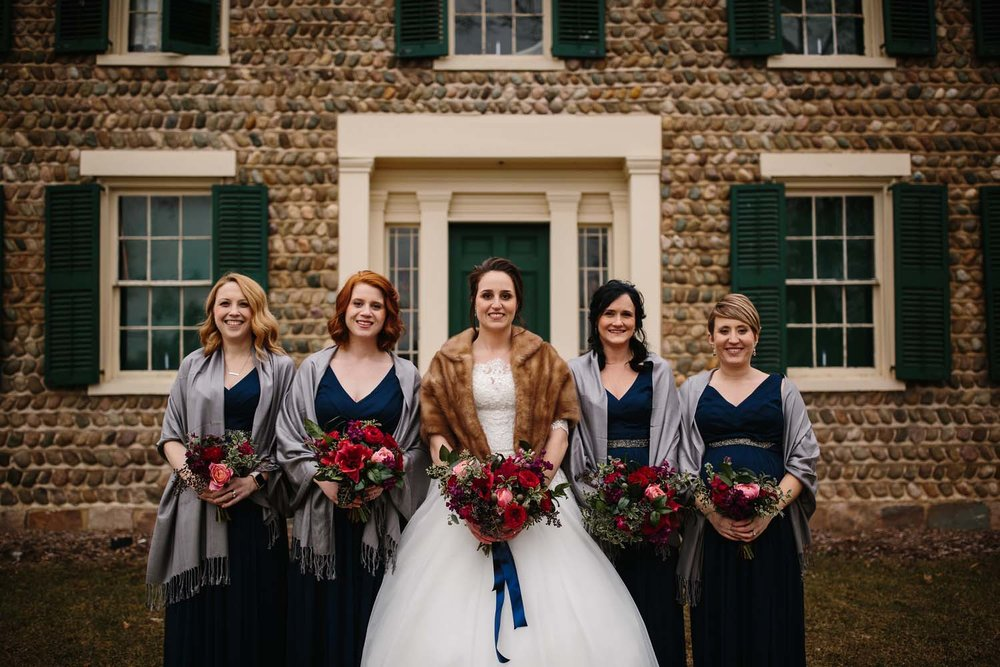 navy bridal party dresses flowers
