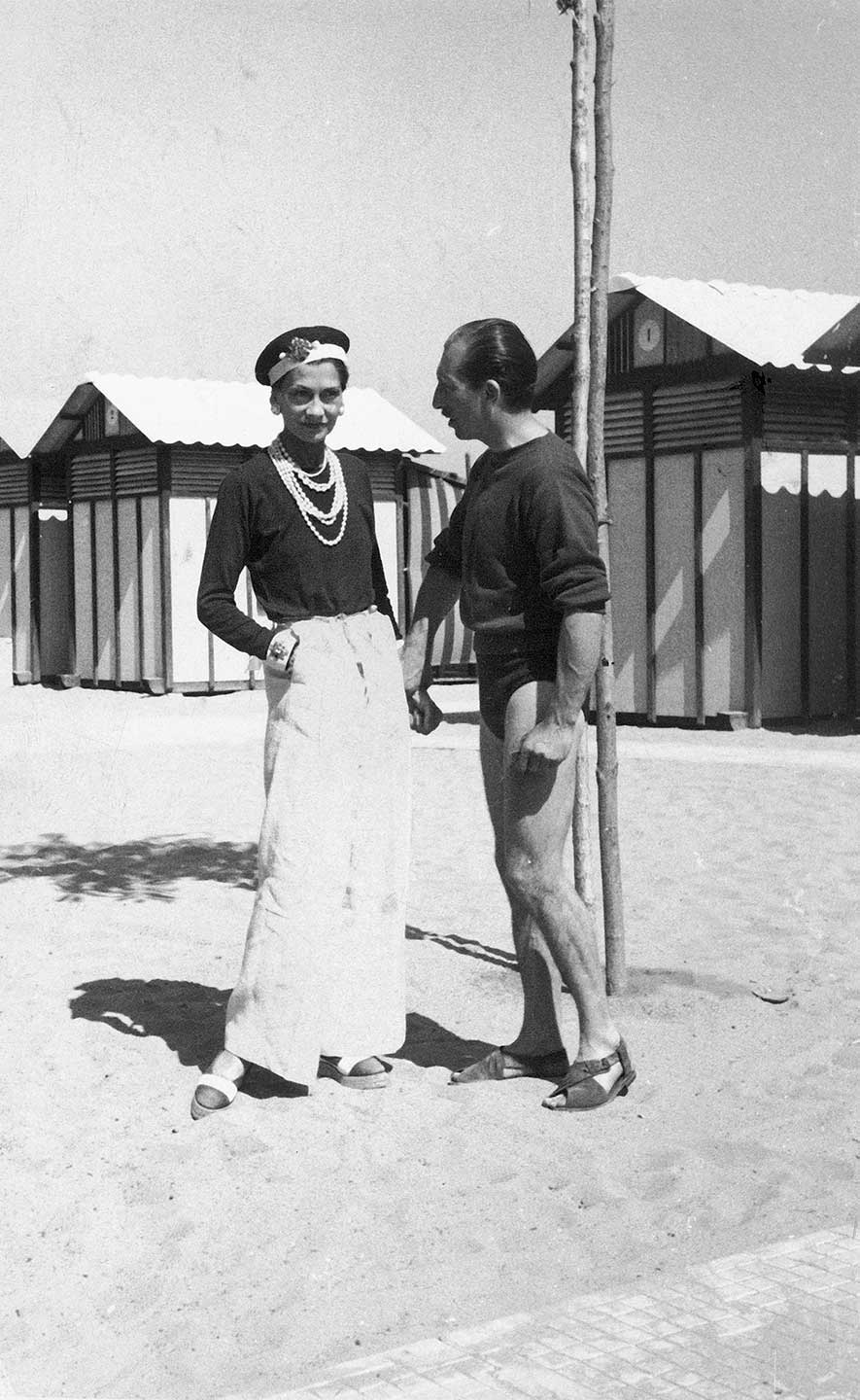 Fashion designer Coco Chanel with Duke Laurino of Rome on beach at the Lido Image courtesy Time Life Pictures/Pictures Inc./The LIFE Picture Collection/Getty Image
